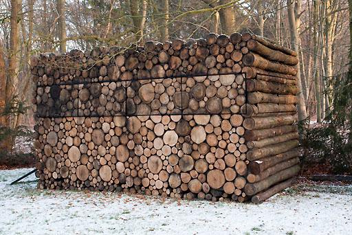 savvyhousekeeping log cabin backyard tree trunk garden house