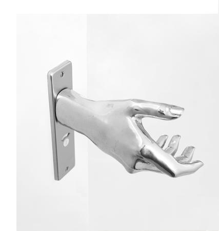 savvyhousekeeping door knob shaped like a hand hand-le